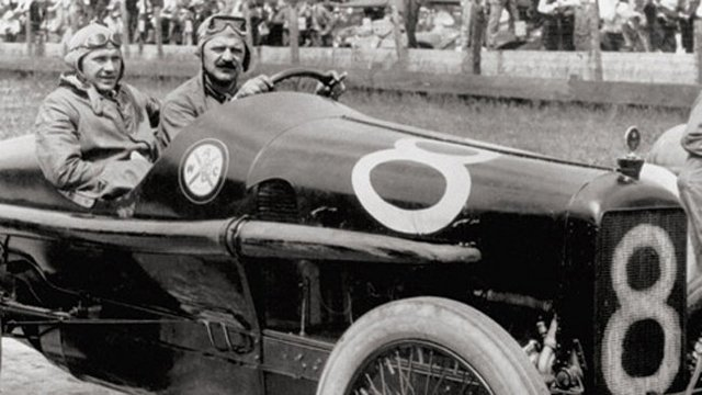 Louis Chevrolet is shown driving Durant around a track in this photo.