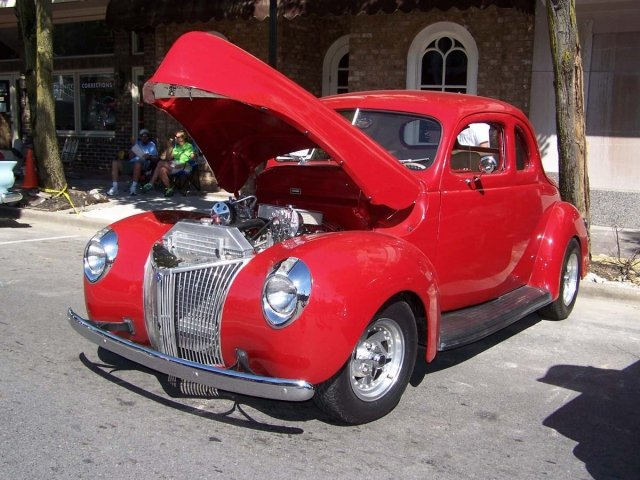 This '39 Ford Coupe is coated in classic hot rod red.