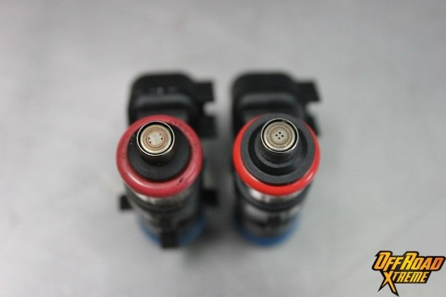 The stock injector (left) is compared with the ProCharger injector (right). Note the grouping of the jets on the ProCharger unit, as well as their slightly larger diameter.