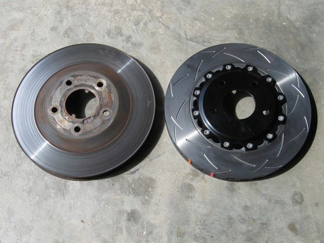 Here, you can see a stock front rotor (left) compared to the new DBA disc.
