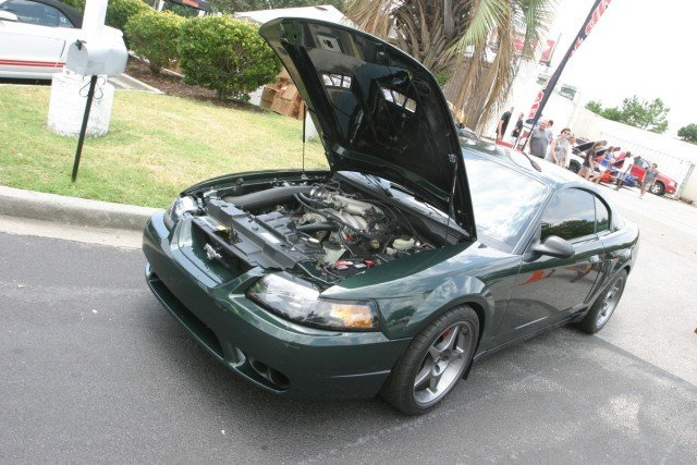 Calvin Atwell always has something up his sleeve when it comes to Mustangs. This year he brought his 2001 Bullitt to the show. If memory serves, he brought his black Bullitt to last year's Mustang Week. That car has a new owner, but it was in attendance, as well. His DHG Bullitt has tasteful mods such as a 1999/2001 Cobra front bumper, 2000 Cobra R wheels, a JLT Performance cold air intake, and a Revolution Automotive tune.