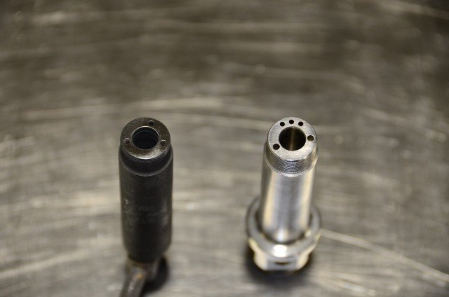 At left is a stock, IH injector body with a single feed. At right, additional fuel-feed holes are evident in a Scheid billet tri-feed injector body.