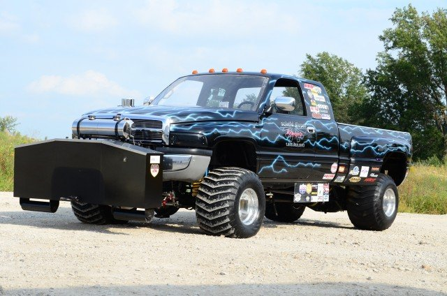 Brad and Susie Ingram's  '96 Ram 3500 is a champion sled puller sponsored by Scheid, and has extensive injector upgrades.