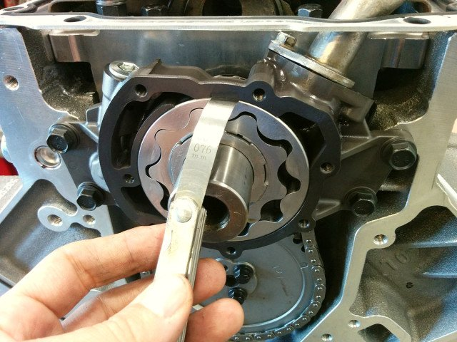Steven Balusik Melling says the 10295 high pressure oil pump is calibrated to give a 10% increase of oil pressure. The feeler gauges were used to assure that the pump was properly centered on the crankshaft before the bolts were tightened.