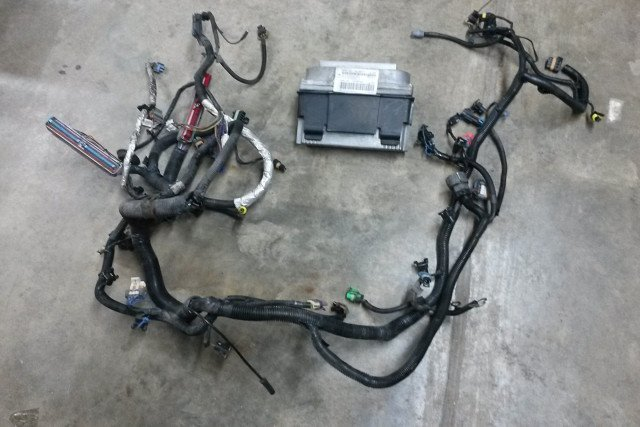 The harness and PCM from a '99 Camaro Z28 was bought and modified to fit the '01 C4. Image courtesy bigcommerce.com.