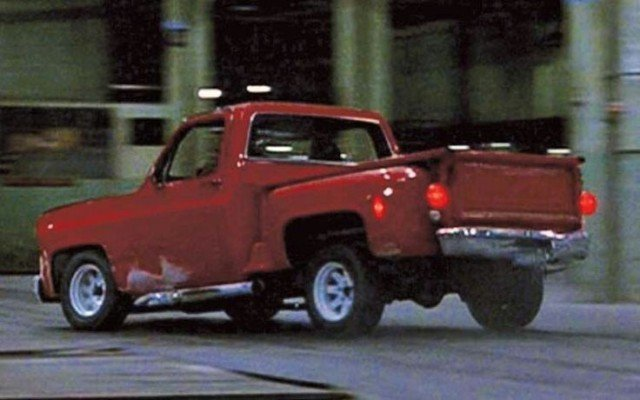The chase inside a warehouse, with the Driver in the Chevy C10.
