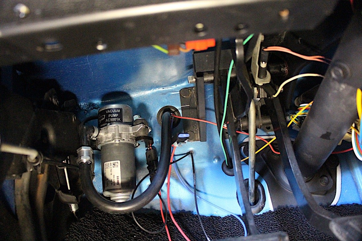 the pump ended up being quiet enough that it was mounted inside the car  where there was a good spot for it, just behind the firewall