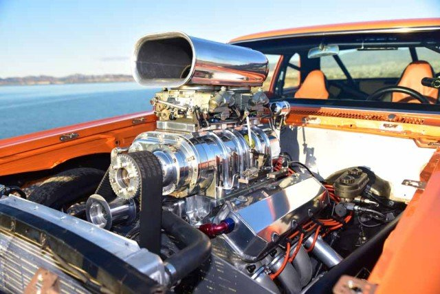"Scotts ""self built"" all aluminum blown 572 cubic inch engine produces well over 800 horsepower! He just loves ""blowers"" He also has a similar combo in his 7 second Chevy Luv truck!"