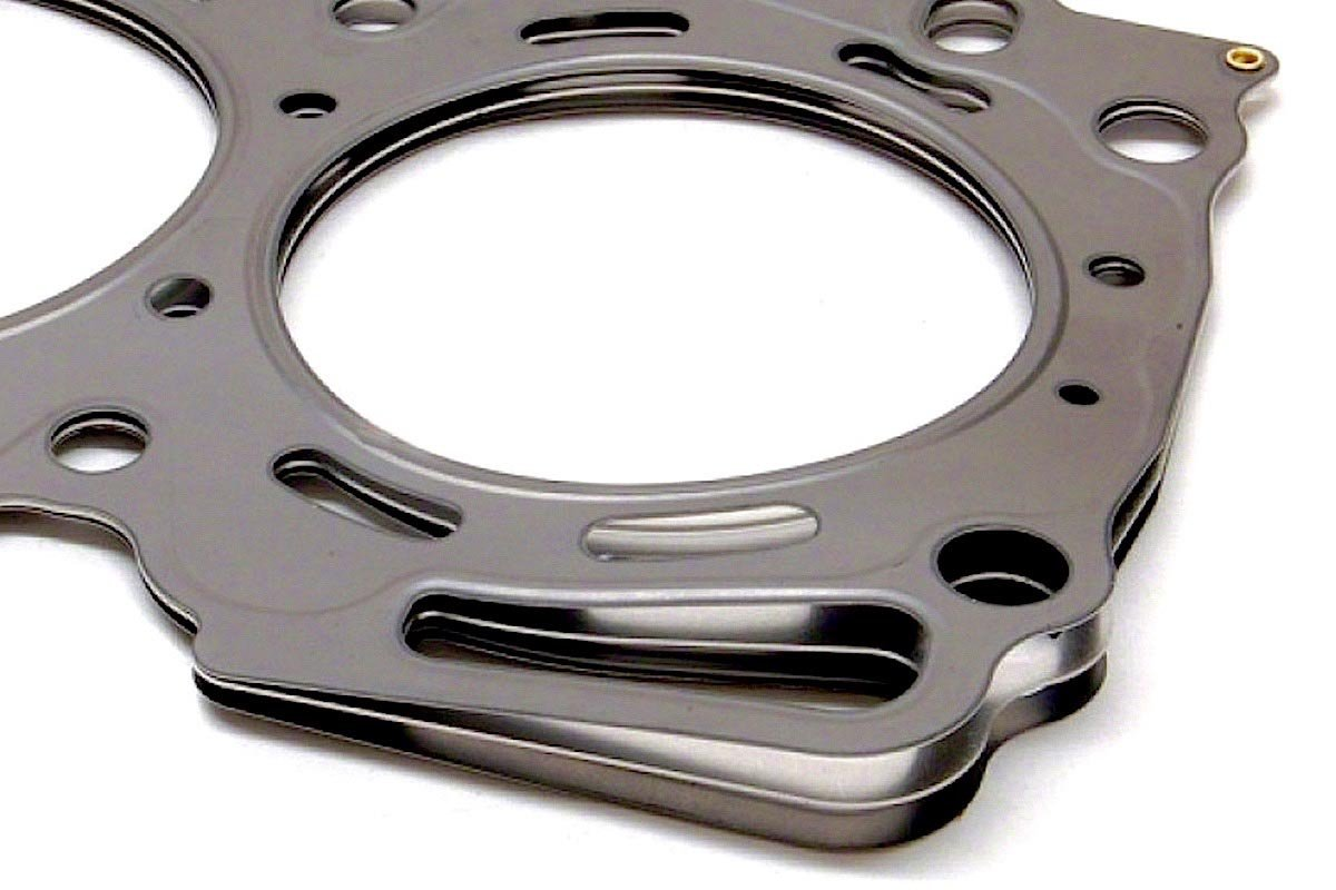 Mls head gaskets theres more to it than just bolting them in place an mls gaskets ability to protect against blow out in high cylinder pressure situations is due to the embossed solutioingenieria Gallery