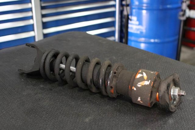 Here's what a coilover looks like after three years of daily driver use and almost 30,000 miles. Fortunately, a factory rebuild will bring our set back to like-new condition.