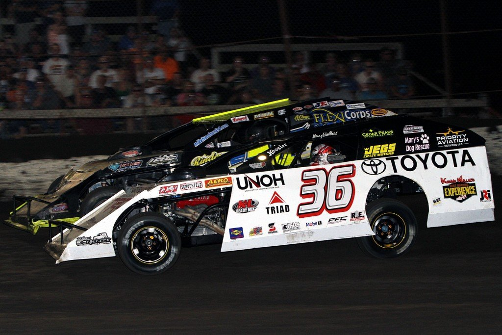 Kenny Wallace (36) and Mike Harrison race for the lead at Macon.