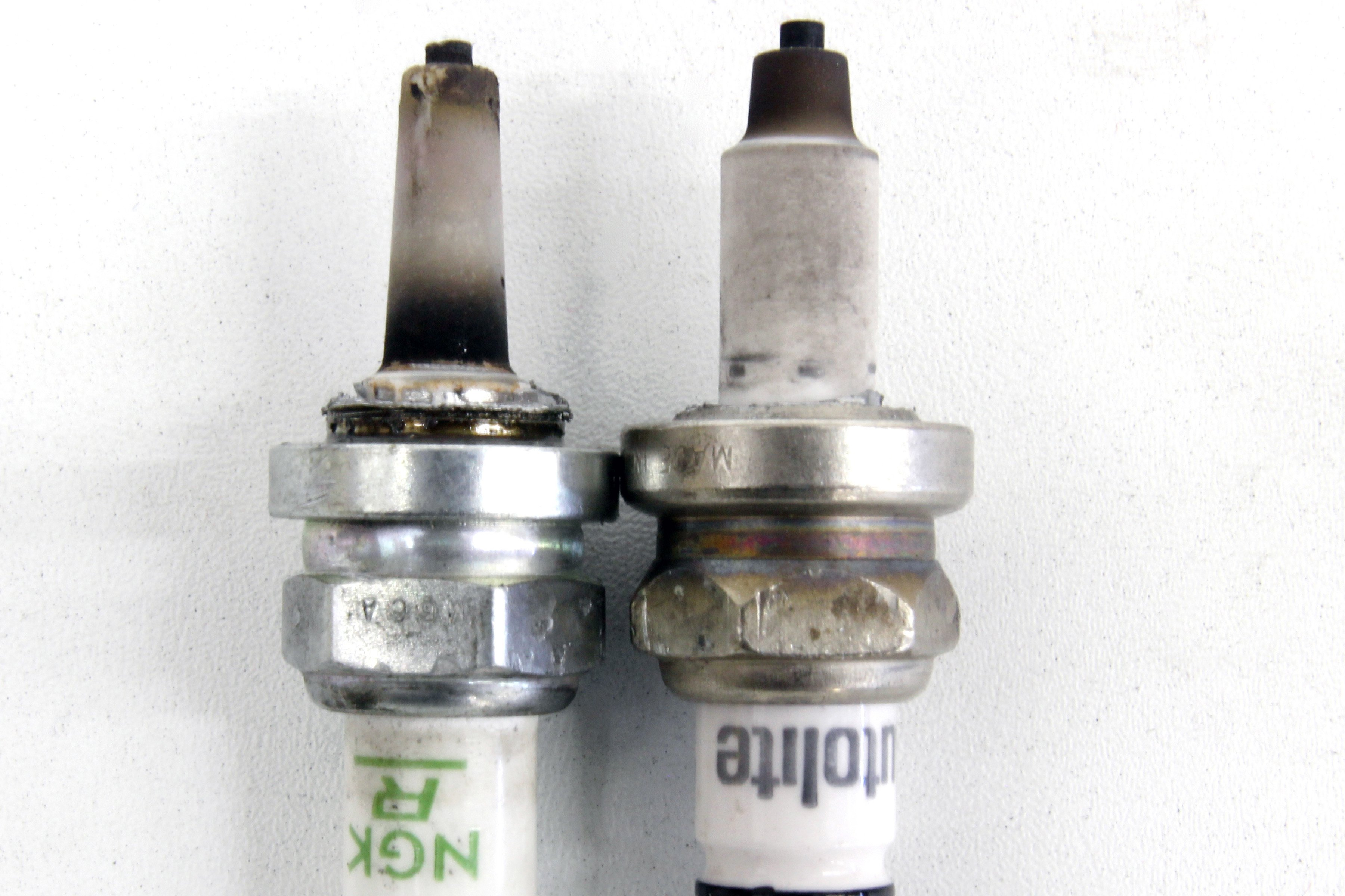 The Great Spark Plug Debate Separating Fact From Opinion After Inserting Wires To Place Into Proper Slot We Removed Threads On These Two Plugs Illustrate Heat Range Left Is A Hotter Than Right