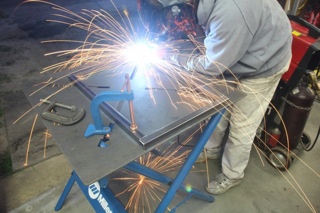 We first tacked all four corners together and rechecked to ensure the angles were still square and then welded the rectangle and set it aside to cool.